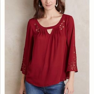 Anthropologie Maeve red laser cut blouse